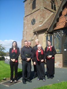 Some of the Beaumaris Singers prepare for their Lilleshall Concert